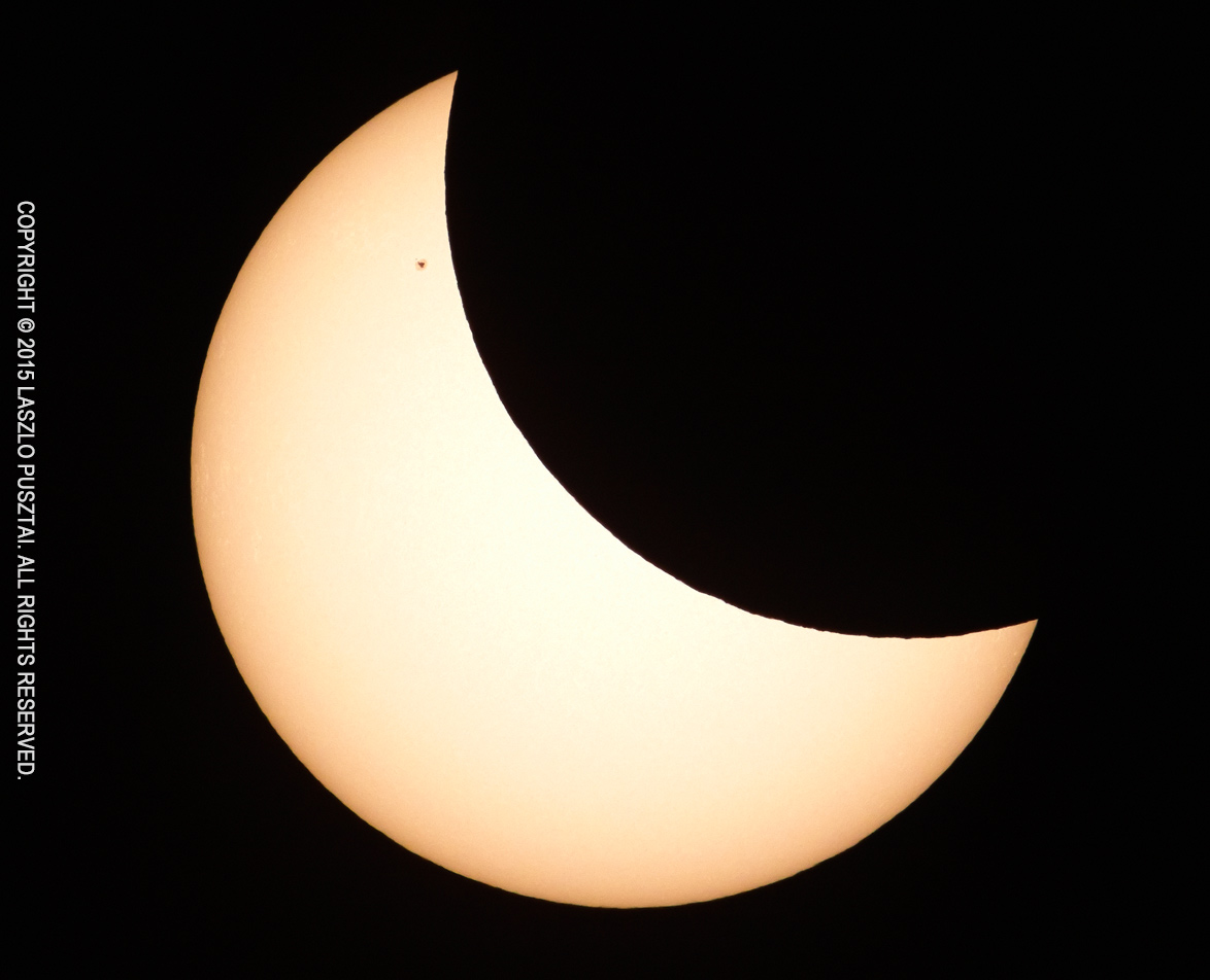 Partial Solar Eclipse with Sunspot 2303