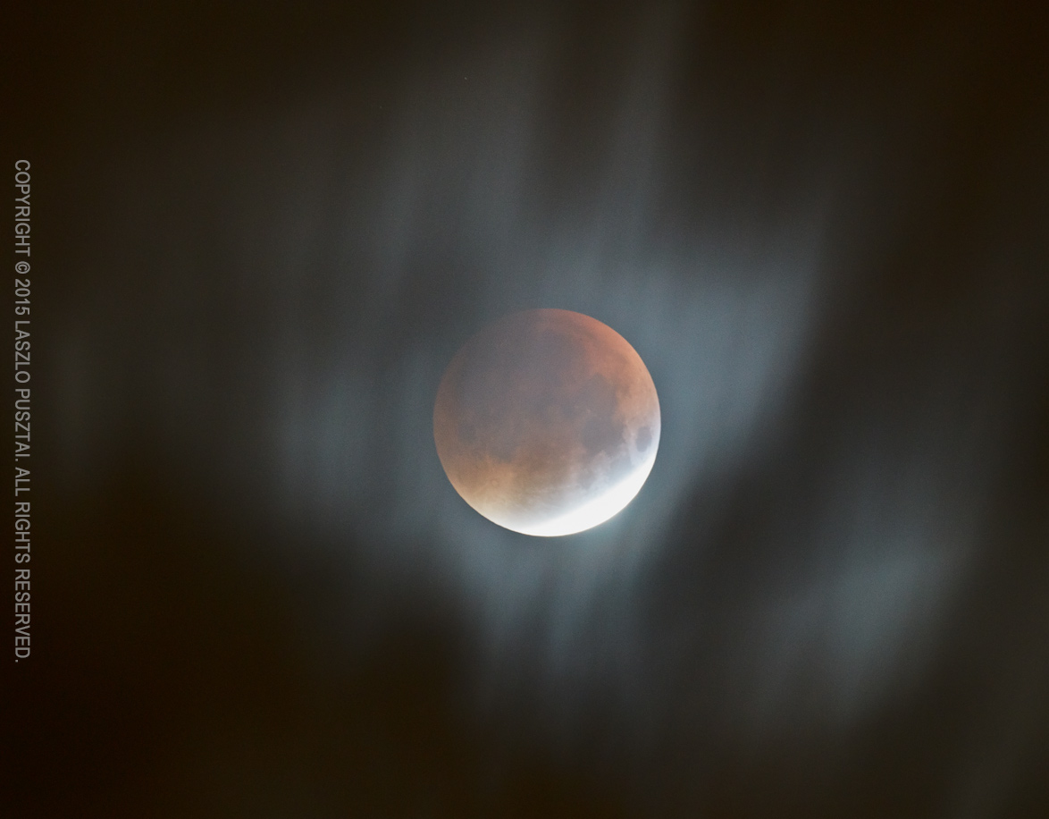 Eclipse Through the Clouds